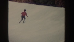 1962: two individuals skiing down hillside NEW YORK Arkistovideo