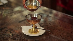 Man waters the dessert honey in indian restaurant Stock Footage