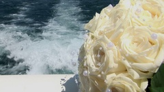 The waves from motor speed boat decorated with wedding bouquet Stock Footage