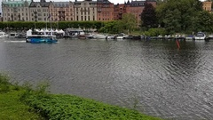 STOCKHOLM, SWEDEN: Unique shot of a bus sailing in river water Stock Footage