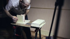 Male worker makes blanks for wooden boxes Stock Footage