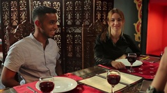 The swarthy man talking with friends in restaurant Stock Footage