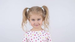 One cute little girl smiling isolated on white close up Stock Footage