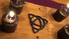 Triquetra candles pagan altar Stock Footage
