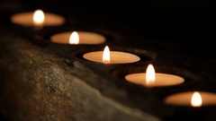 CU SELECTIVE FOCUS Row of flickering candles Stock Footage