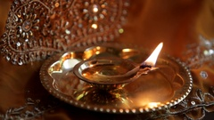 CU Burning oil lamp on small gold tray Stock Footage