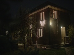 Beautiful decorated wooden house decorated with Christmas lights Stock Footage