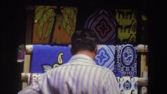 1969: people shopping in a marketplace for linens and bowls SOUTH AFRICA Stock Footage