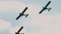 Three small single engine airplanes doing stunts Stock Footage