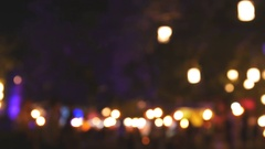 Colorful lights bokeh circles on the dark, out of focus lights during the night Stock Footage