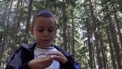Young boy excited to eat patato chips eagerly Stock Footage