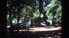 1969: jeep with hood up among the trees in a possible camping or picnicking area Stock Footage