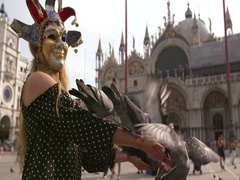 Woman feeding pigeons on St. Mark's Square, Venice, Italy. Stock Footage