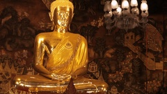 MS TD Golden Buddha statue in temple with worshippers / Wat Pho, Bangkok, Stock Footage