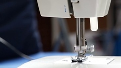 Sewing machine on the table closeup. Machine needle moves Stock Footage