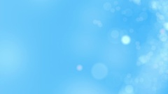 Sky blue motion background. Abstract glowing bokeh circles or sparks. 4K Stock Footage