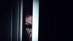 4K Thriller Woman Blackout Eye Looking in Door Gap, zoom in fast Stock Footage