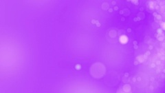 Purple motion background. Abstract glowing bokeh circles or sparks. 4K seamless Stock Footage