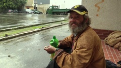 Senior man homeless in city drinking alcohol, wine, drunk, poor authentic Stock Footage