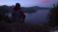 Tourist looking at Crater Lake Oregon Landscape slow camera dolly Stock Footage