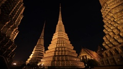 WS LA TU Temple spires at night / Wat Pho, Bangkok, Thailand Stock Footage