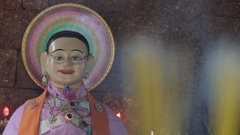 CU R/F Incense burning in front of goddess of fertility / Bangkok, Thailand Stock Footage