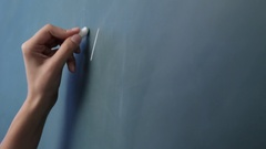 CU PAN TD Woman writing mathematical formula on blackboard, view of hand Stock Footage