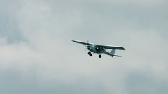 White light single aircraft in the air Stock Footage
