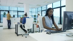 4K Portrait smiling businesswoman working at her desk in modern office Stock Footage
