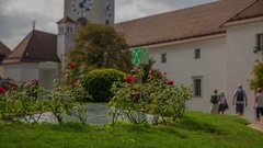 Roses and a tower inside the Ljubljana fortress Stock Footage