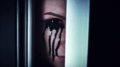 4K Scary Woman Blackout Eye Looking in Door Gap Stock Footage