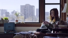 Young Woman Dances Along To Song On Record Player, Plays On Phone In Cute Loft Stock Footage