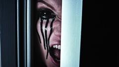 4K Scary Woman Blackout Eye Screaming in Door Gap Stock Footage