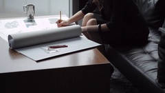 TU MS Young business woman writing, sitting at coffee table by window/ Beijing, Stock Footage