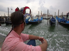 Man with a carnival mask looking at gondolas in San Marco, Venice, Italy. Stock Footage
