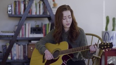 Young Woman Plays Guitar In Her Trendy Studio Stock Footage