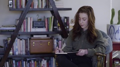 Young Woman Writes In Her Journal In Trendy Studio Stock Footage
