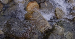 Moving over foaming river water with stones, high frame rate Stock Footage