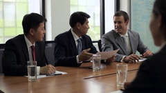MS Three businessmen meeting with businesswoman in conference room / Beijing, Arkistovideo