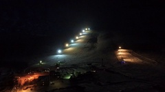 Night flight to the slope of the ski resort. Stock Footage