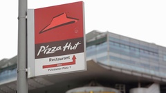 Pizza Hut restaurant direction sign, Potsdamer Platz, Berlin, Germany Stock Footage