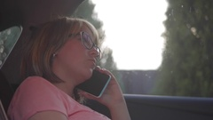 Woman talking on mobile phone sit in car Stock Footage