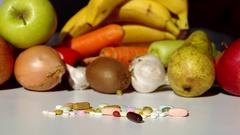 Fruit, vegetables, or medicines ? Stock Footage