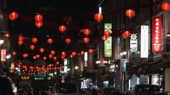 WS Chinese lanterns hanging above street at night / Chinatown, Singapore Stock Footage