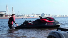 Man Towing Jet Ski on the Water Prepare for Speed Racing Stock Footage