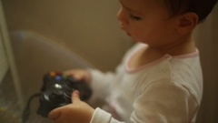 Sweet, baby boy playing a computer game pad Stock Footage
