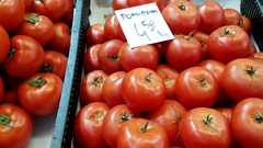 Dolly shot right to left over different type of tomatoes for sale Stock Footage