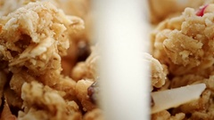 Pouring a milk into a bowl of cereals Stock Footage