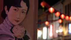 CU Painted mural of Chinese woman with lanterns in background / Singapore Stock Footage