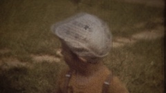 Family Chronicle: Little boy walks in a city park Stock Footage